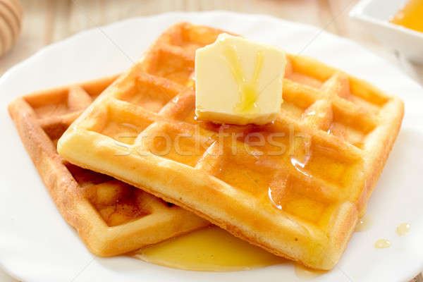 Waffles with honey and butter Stock photo © badmanproduction