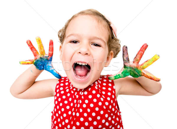Positive child with colorful hands Stock photo © badmanproduction