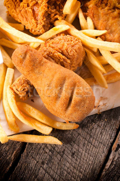 Stock photo: Chicken legs and french fries