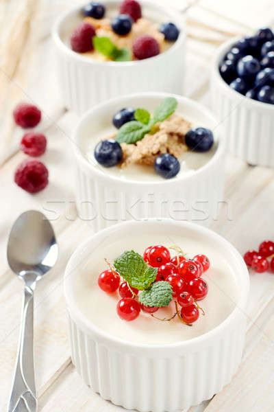 Panna cotta with berry fruits Stock photo © badmanproduction