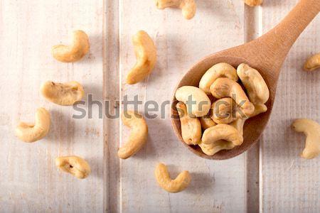 Kesudió halom diók fölött fából készült merőkanál Stock fotó © badmanproduction