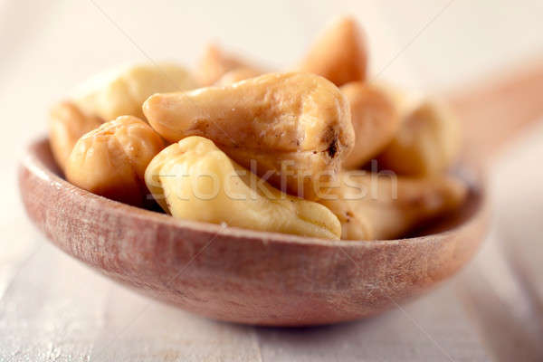 Cashew nuts in ladle Stock photo © badmanproduction