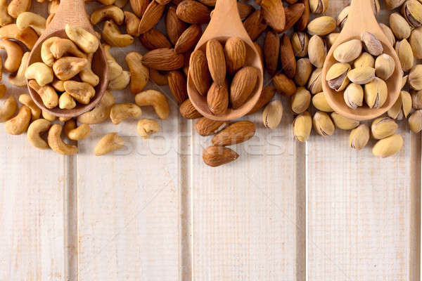 Nuts mix in ladles Stock photo © badmanproduction