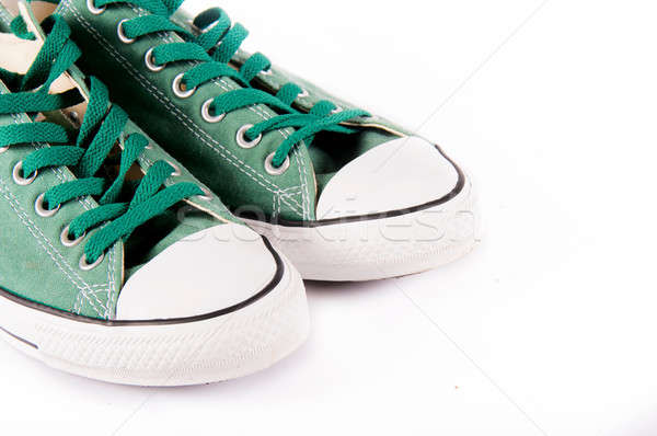 Sneakers on white Stock photo © badmanproduction