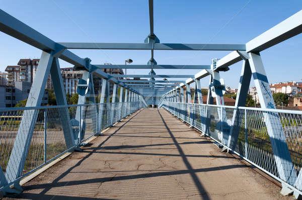 Pont pied bâtiments rivière énergie concrètes Photo stock © badmanproduction