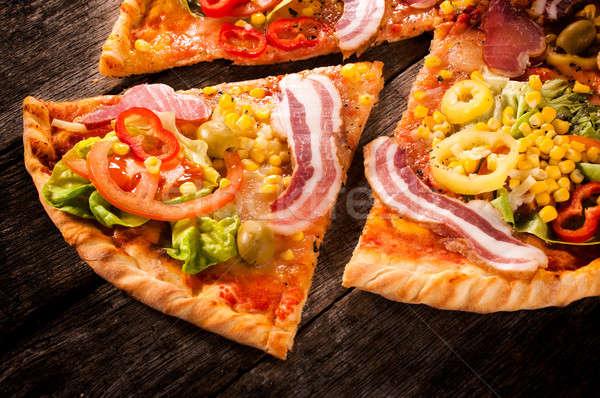 Pizza slice plakje focus voedsel hout Stockfoto © badmanproduction