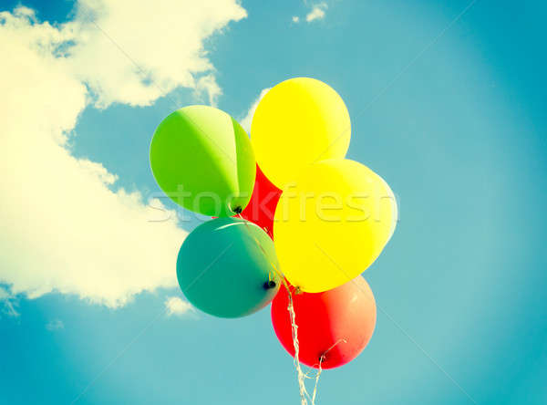 Kleurrijk ballonnen lucht vliegen hand ruimte Stockfoto © badmanproduction