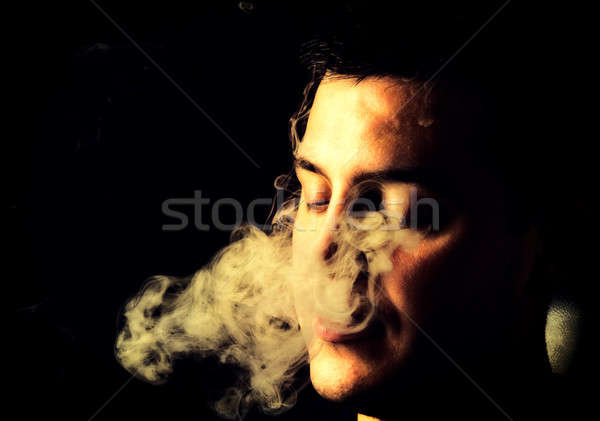 Smoking man Stock photo © badmanproduction