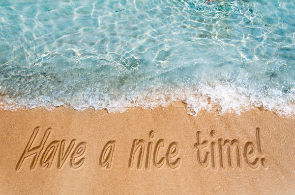 Mooie tijd teken strandzand strand achtergrond Stockfoto © badmanproduction