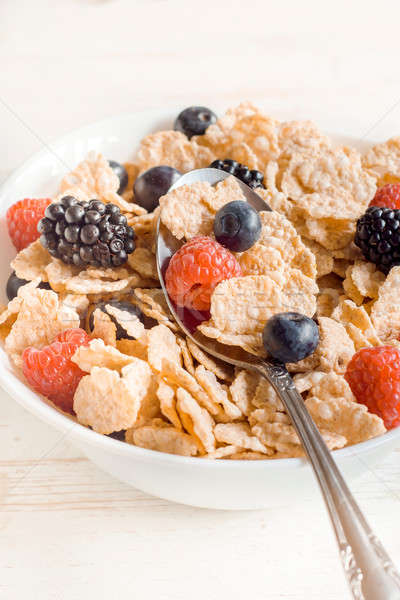 Stock photo: Corn flakes and berry fruits