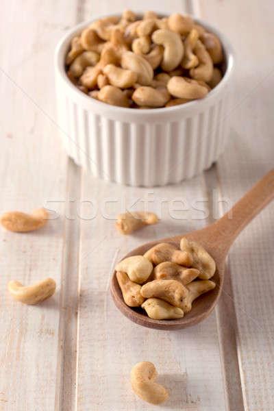Noten pollepel selectieve aandacht houten vruchten gezondheid Stockfoto © badmanproduction