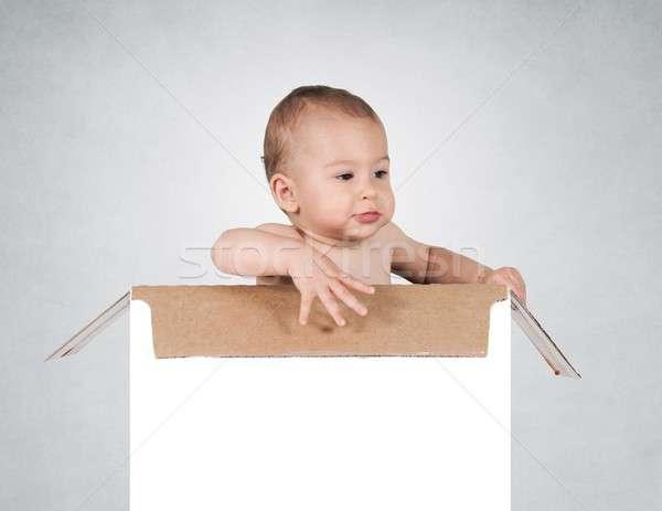 Baby in box Stock photo © badmanproduction