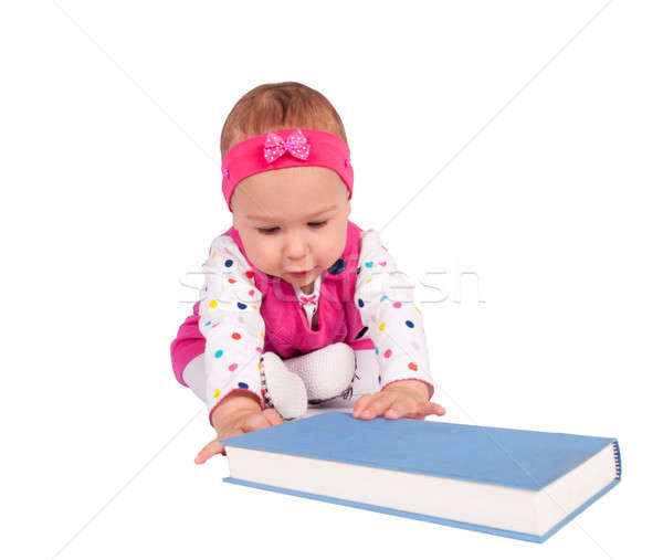 Baby and book Stock photo © badmanproduction