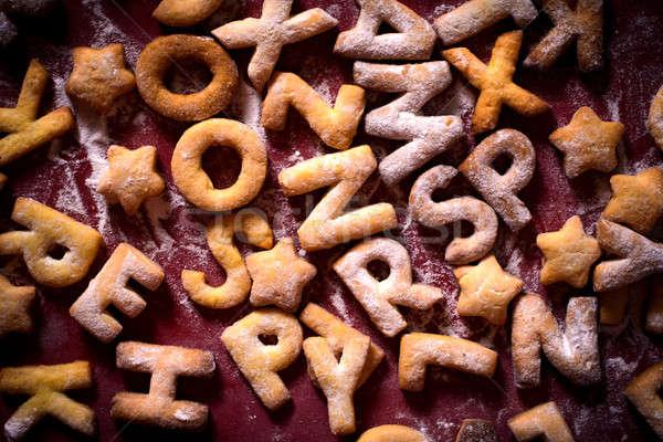 Kurabiye harfler şeker toz soyut Stok fotoğraf © badmanproduction