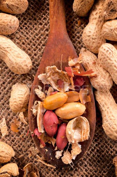 Cacahuètes louche groupe bois texture santé Photo stock © badmanproduction