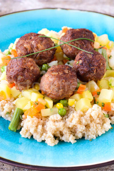 Meat balls and couscous with vegetables Stock photo © badmanproduction