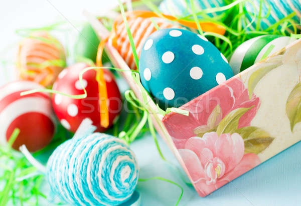 Easter eggs in the box Stock photo © badmanproduction