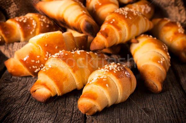 Gouden gebak gevuld croissant vorm voedsel Stockfoto © badmanproduction