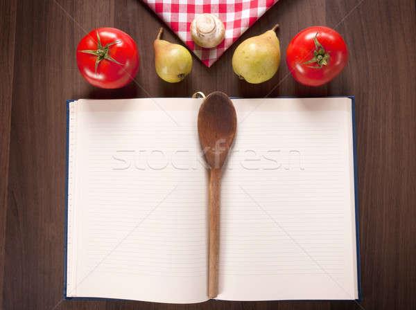 Książka kucharska drewniany stół tle ramki przestrzeni notebooka Zdjęcia stock © badmanproduction