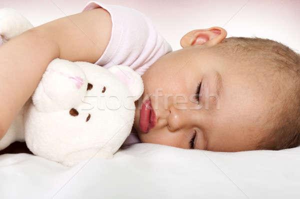 Baba alszik kicsi alszik ölelés játék Stock fotó © badmanproduction