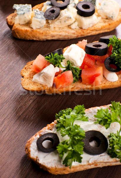 Három szelektív fókusz bruschetta középső ital sajt Stock fotó © badmanproduction