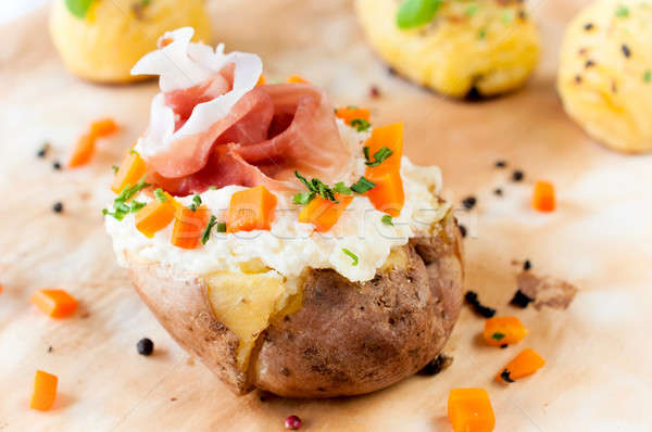 Baked potato and prosciutto Stock photo © badmanproduction