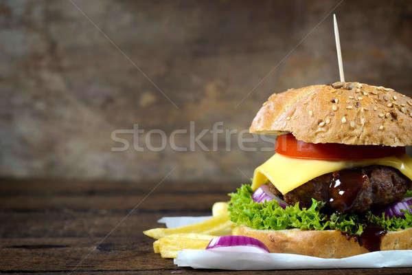Succosa cheeseburger carta design ristorante tavola Foto d'archivio © badmanproduction
