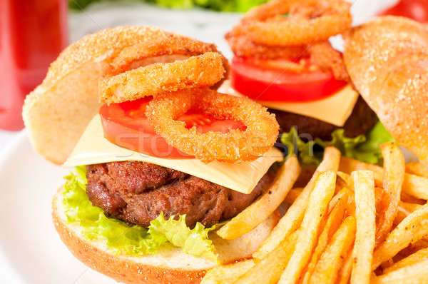 Cheeseburger profonde frit oignon accent viande Photo stock © badmanproduction