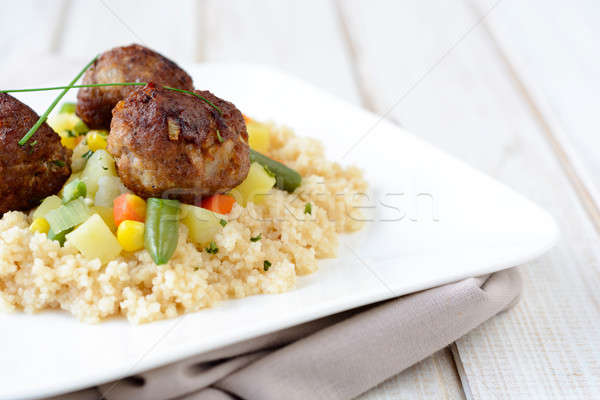 Couscous and meat balls Stock photo © badmanproduction