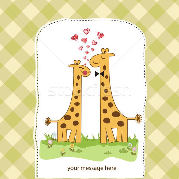 Funny giraffe couple in love Stock photo © balasoiu