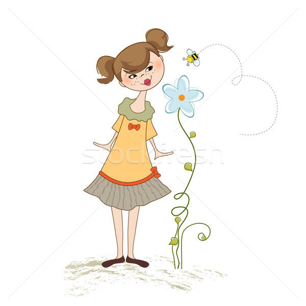 small young lady who smells a flower Stock photo © balasoiu