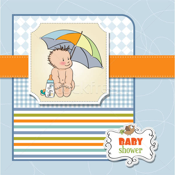 baby boy shower card with funny baby under his umbrella Stock photo © balasoiu