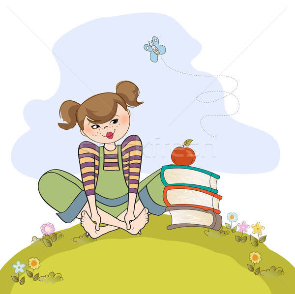 studious girl sitting barefoot in the grass Stock photo © balasoiu