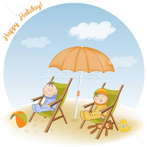two children sits on the beach Stock photo © balasoiu