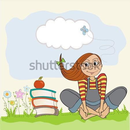 Genç tatlı kız okuma kitap kedi Stok fotoğraf © balasoiu