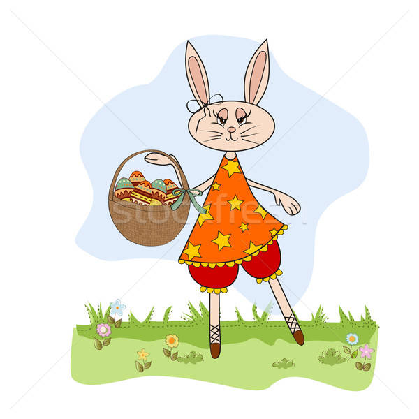 Stock photo: Easter bunny with a basket of Easter eggs