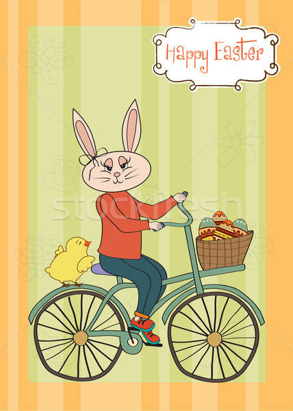Easter bunny with a basket of Easter eggs Stock photo © balasoiu