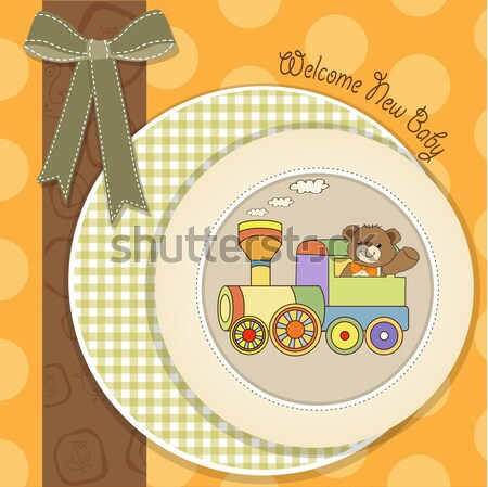 funny teddy bear in stroller Stock photo © balasoiu