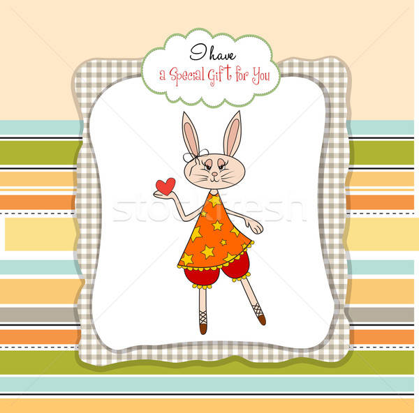 Stock photo: cute little doe who gives her heart. romantic and funny love gre