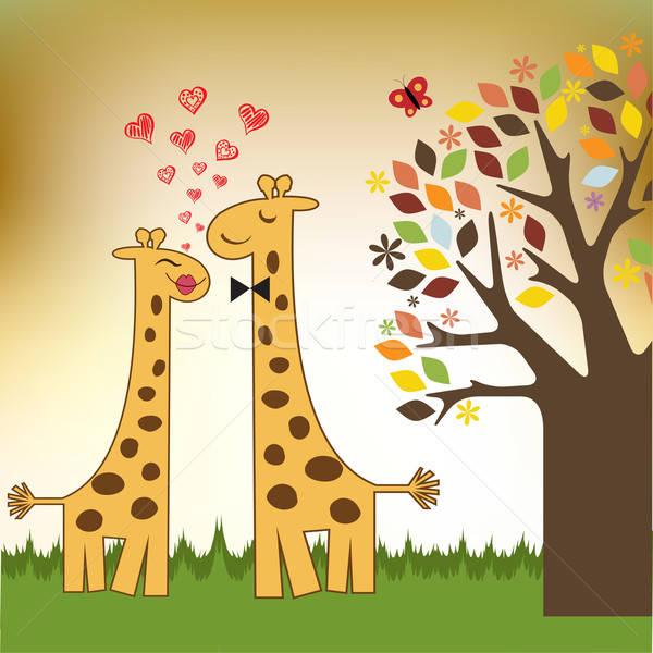 Stock photo: Funny giraffe couple in love