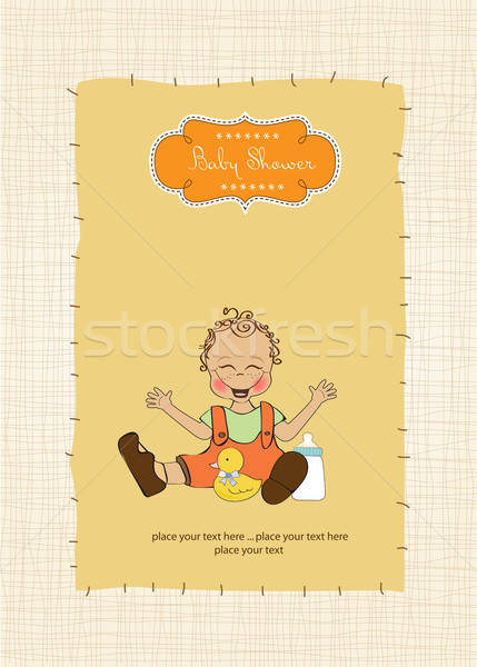 baby boy playing with his duck toy, welcome baby card Stock photo © balasoiu