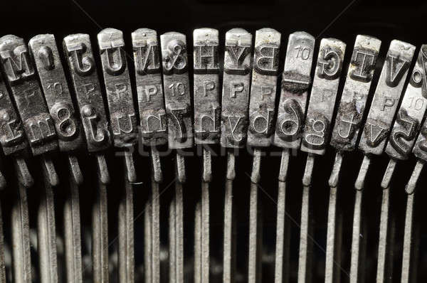 Close-up of typewriter letter and symbol keys Stock photo © Balefire9