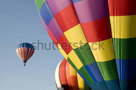 Hot air balloons launching against a blue sky Stock photo © Balefire9