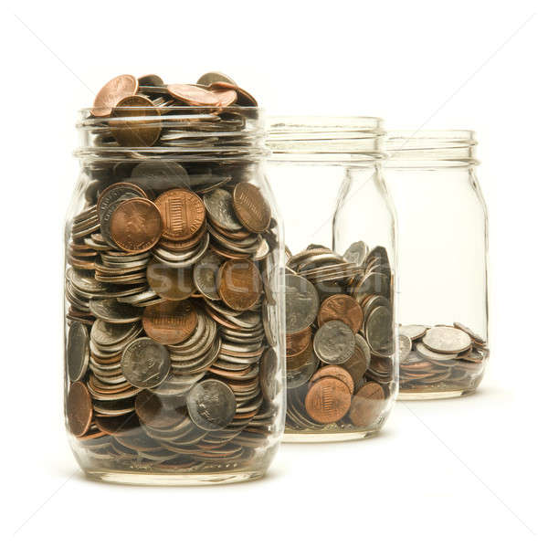Three glass jars filled with American coins Stock photo © Balefire9