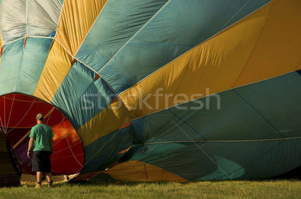 Man inflating a hot-air balloon with a burner Stock photo © Balefire9