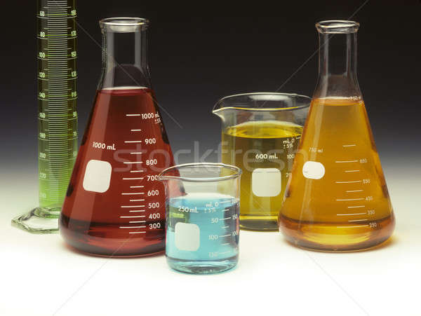 Scientific glassware filled with colored liquids Stock photo © Balefire9