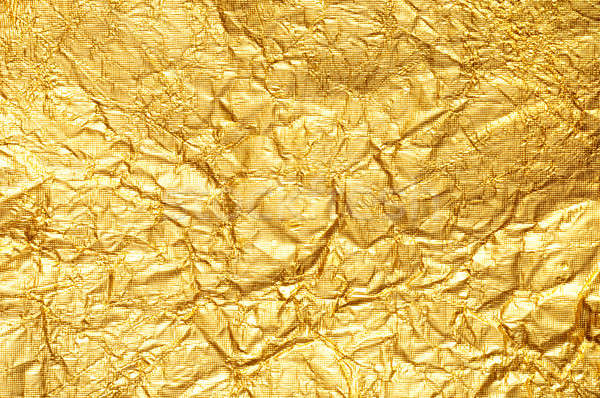 Crumpled gold foil textured background Stock photo © Balefire9
