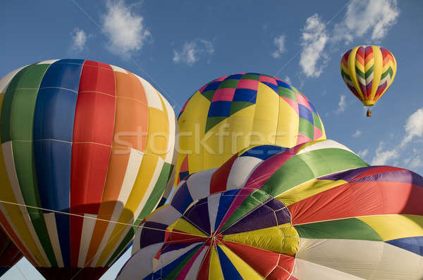 Hot-air balloons inflating with another balloon already aloft Stock photo © Balefire9