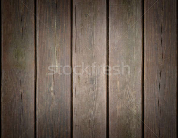 Weathered wooden plank background with dark edges Stock photo © Balefire9