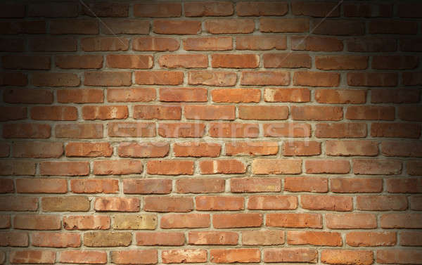 Stock photo: Weathered red brick wall texture lit from above
